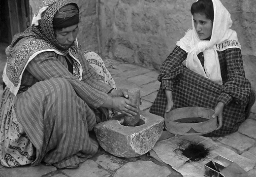 Palestinian women grinding coffee beans