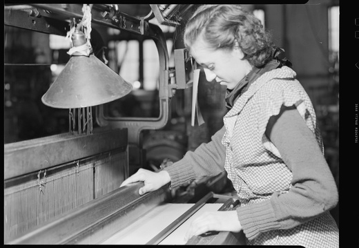 Paterson, New Jersey - Textiles. Examining the fabric on the loom. - NARA - 518582