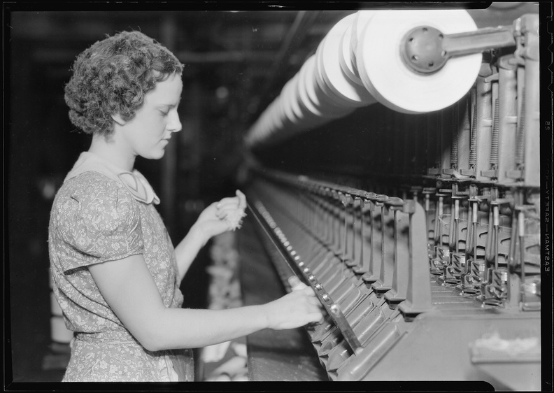 Millville,_New_Jersey_-_Textiles._Millville_Manufacturing_Co._(Woman_pulling_thread.)_-_NARA_-_518677.jpg