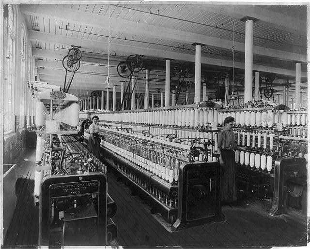 Textile_factory_with_two_women_at_machines_LCCN2004674560.jpg